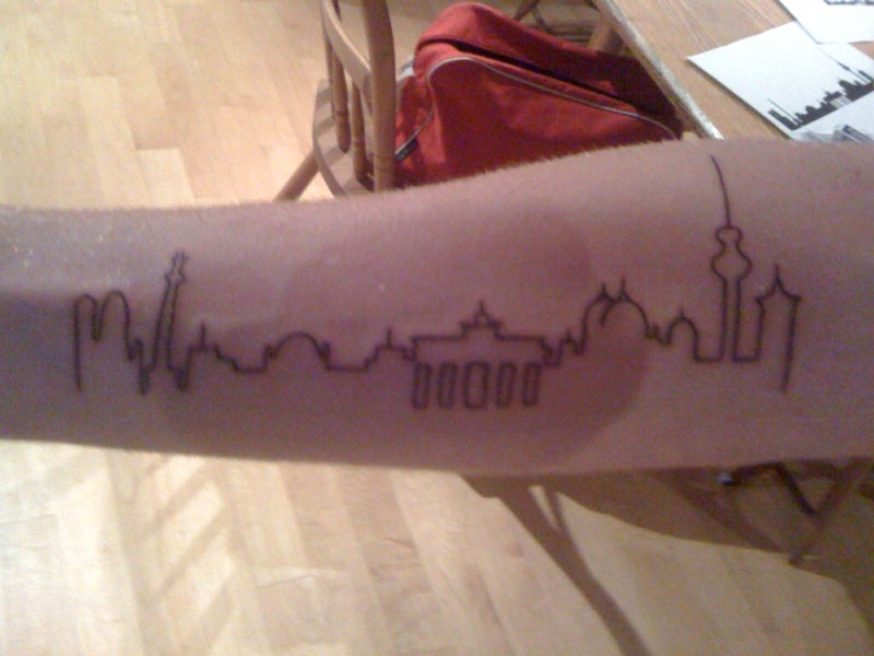 a tattoo of the Berlin skyline on his arm while Ted was away.